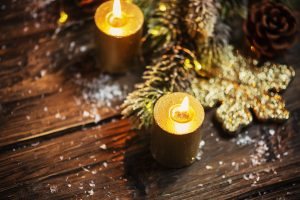 Christmas decoration with gold candles and light