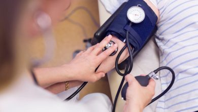 doctor-measuring-senior-womans-blood-pressure